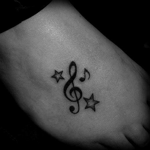 53 Tatuajes De Música Instrumentos Grupos Y Notas Musicales