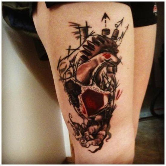 foto tatuaje pierna muslo 221