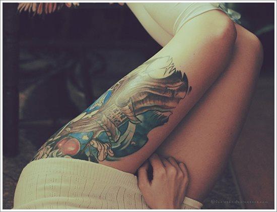 foto tatuaje pierna muslo 238