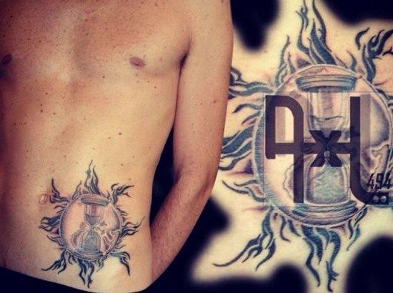 tatuaje reloj arena 326