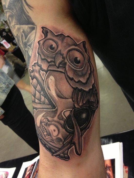 tatuaje reloj arena 328