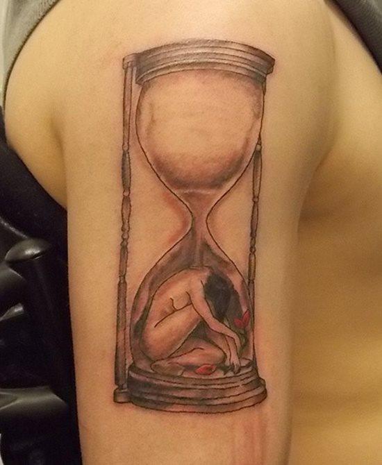 tatuaje reloj arena 332