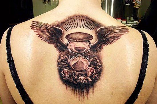 tatuaje reloj arena 338