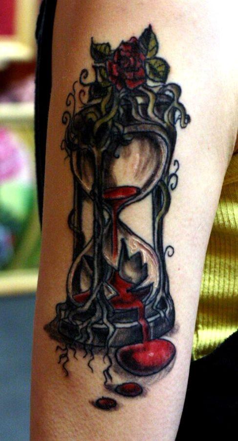 tatuaje reloj arena 340