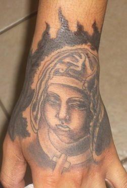 tatuaje mano 1037