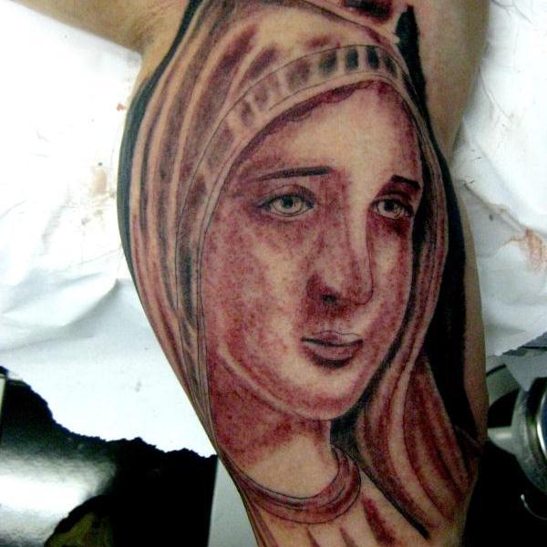 tatuaje virgen 42
